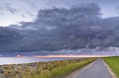 bike path or walking trail along the north sea, wremer tief, wremen, lower sa - stock photo