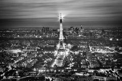 eiffel tower light performance show at night, paris, france. aerial view. bla - stock photo