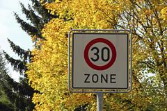 Stock Photo of sign, 30km/h tempo limit zone, autumn, city district of mittelberg, stadt bib