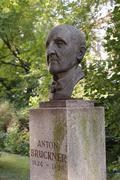 Stock Photo of bust of anton bruckner in front of the palais meran, graz, styria, austria, e