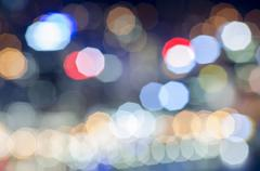 Coloured lights as fuzzy, abstract points of light with coloured lens flare Kuvituskuvat
