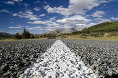 White road markings on a road with coarse asphalt, worm's eye view, arthur's  Kuvituskuvat
