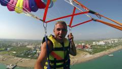 Man Parasailing High in the Sky Stock Footage
