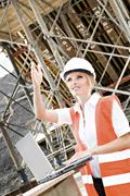 Stock Photo of young female constructor at building site of a new motorway, germany, europe