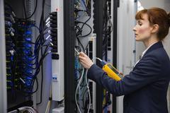 Technician using digital cable analyzer on server Stock Photos