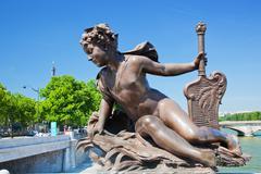 Stock Photo of artistic statue on alexandre bridge against eiffel tower. paris, france