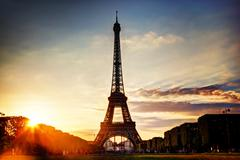 eiffel tower seen from champ de mars at sunset, paris, france - stock photo