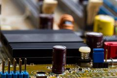 Microchips assembly on the circuit board macro Stock Photos