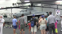 U.S. Marines and sailors take the public on a tour of the ship USS Essex Stock Footage