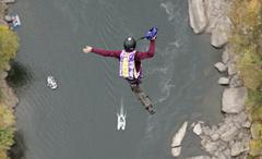 base jumpers leap from the new river gorge bridge during 'bridge day 2008'. o - stock photo