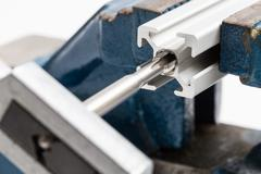 thread cutting with a vise and taps - stock photo