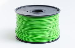Filament for 3d printer in light green against a bright background Stock Photos