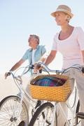Stock Photo of Happy senior couple going for a bike ride