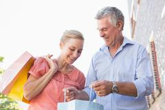 Happy senior couple looking at their purchases Stock Photos