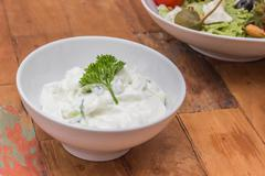 Greek tzatziki garnished with parsley Stock Photos