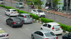 Stock Video Footage of george town, penang, malaysia - 22 jul 2014: normal movement of cars on a cit