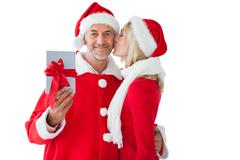 Stock Photo of Festive couple embracing and holding gift