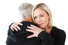 Emotional woman hugging her partner Stock Photos