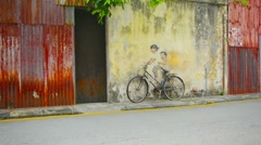 George town, penang, malaysia - 22 jul 2014: little children on a bicycle, mu Stock Footage