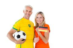 Stock Photo of Football fan couple cheering and smiling at camera