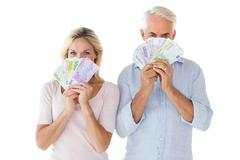 Stock Photo of Happy couple flashing their cash
