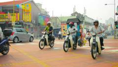 George town, penang, malaysia - 22 jul 2014: movement of motorcycles, cars an Stock Footage