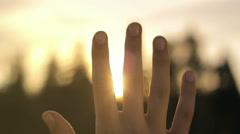 Close-up of human hand in the sky, hopeful, spirit, camera movement Stock Footage