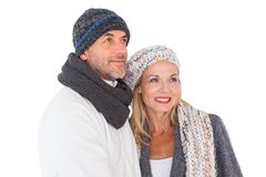 Happy couple in winter fashion embracing - stock photo