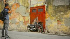 George town, penang, malaysia - 22 jul 2014: boy on a bike - wall painting an Stock Footage