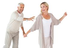 Happy couple messing about together - stock photo