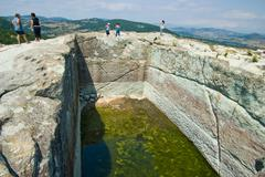 ancient water tank. the ancient thracian city of perperikon. - stock photo