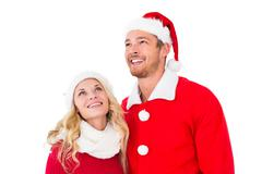 Stock Photo of Festive couple smiling and looking up