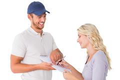 Happy delivery man getting signature from customer Stock Photos