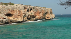 Beautiful coast with bright rock and turquoise blue water (FULL HD) Stock Footage