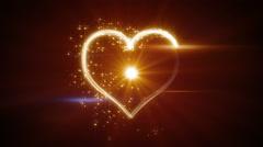 Shiny heart shape yellow light streaks loopable Stock Footage
