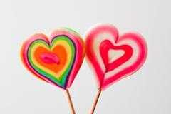 Colorful heart shaped lollipops on grey background. love, fun, valentine's da Stock Photos