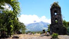 Mayon Volcano behind cagsawa ruins Stock Footage