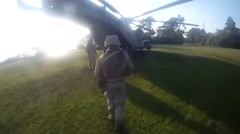 Troops soldiers entering an helicopter Stock Footage