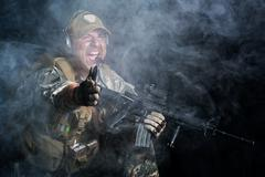 A soldier in the smoke after the explosion Stock Photos