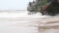 Amphibious Assault Vehicles performing an assault on Onslow Beach Stock Footage