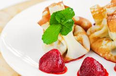 Crepes with curd cheese and strawberries Stock Photos