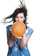 Happy young woman holding baloon Stock Photos
