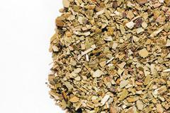 dry yerba mate leaves on white background. a popular south american drink kno - stock photo