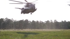 Helicopters performing an assault on Onslow Beach - stock footage