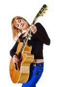 Rocker with acoustic guitar Stock Photos