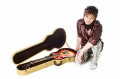 rocker with guita - stock photo