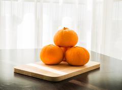 oranges set on wooden base - stock photo
