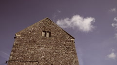 Old church / building, clouds passing by Stock Footage