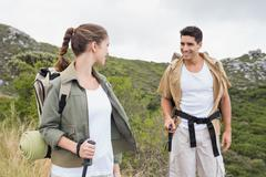 Stock Photo of Couple walking on mountain terrain