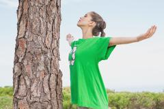 Female environmental activist in front of tree trunk Stock Photos